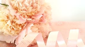 Peonies. Bunch of peonies with decorative packing tape on the table Royalty Free Stock Image