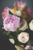 Peonies and roses bouquet. Shabby chic pastel bouquet. Peonies and roses bouquet. Shabby chic pastel colored wedding bouquet. Closeup view, selective focus stock image