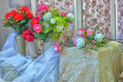 Peonies and roses Stock Photo