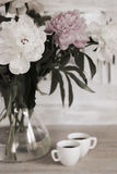Peonies in the vase, two cups of coffee Royalty Free Stock Photography
