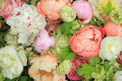 Peonies in a wedding arrangement