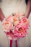 Peonies wedding bouquet. A bride holding her peonies bouquet Stock Images