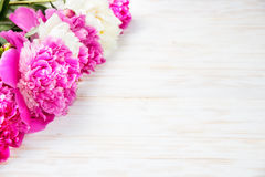 Peonies on a wooden table. Royalty Free Stock Images