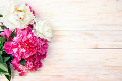 Peonies on a wooden table. Royalty Free Stock Photography