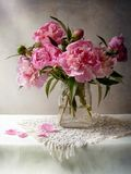 Peony bunch. Beautiful peony bunch on the table royalty free stock photos