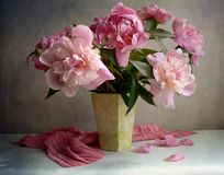 Peony bunch. Beautiful peony bunch on the table stock photos