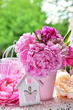 Peony bunch in vase on the table in the garden Royalty Free Stock Image