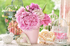 Peony bunch in vase on the table in the garden Stock Photography