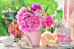 Peony bunch in vase on the table in the garden Stock Photo