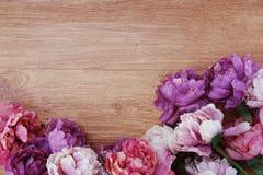 Flower border frame on wooden background Stock Image