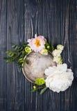 Peony flowers arrangement on old wooden board background. Festiv Stock Photo