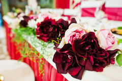 Peony flowers at table of newlyweds at wedding restaurant. Royalty Free Stock Photos
