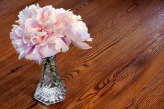 Peony flowers on wooden table Stock Photo