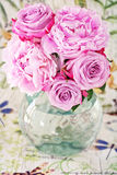 Peony and roses Stock Images