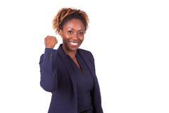 有握紧拳头的-黑peopl非裔美国人的女商人 图库摄影