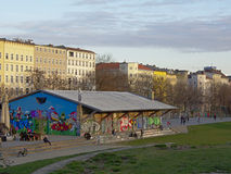 People hanging out around old hangar with graffiti at G�rlitzer parc, Berlin stock image