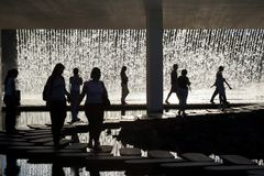 People. Walking in front of a waterfall royalty free stock image