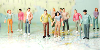 People. Diversity of miniature people travelling on map Stock Images