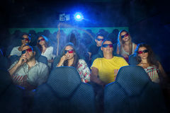 People in 3D Cinema with grim reaper Royalty Free Stock Photo
