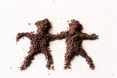 People. Small figures of man made in chocolate powder royalty free stock photo