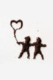 People. Small figures of man made in chocolate powder stock images