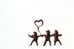 People. Small figures of man made in chocolate powder royalty free stock image