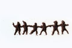 People. Small figures of man made in chocolate powder stock photography