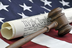 We The People. US Constitution, wooden gavel, and American flag background Royalty Free Stock Photography
