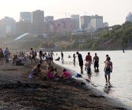 People At Accidental Beach Edmonton Alberta. People enjoying accidental beach in early September 2017 Edmonton Alberta royalty free stock images
