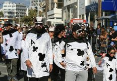 People in ace of clubs card costumes walking along a street stock photos