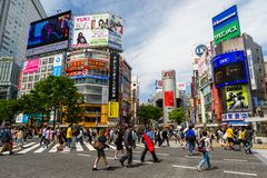 People across Shibuya crossing, Tokyo. Tokyo, Japan- May 6, 2017: Unidentified people across Shibuya crossing with modern city background. Here is very famous of stock image