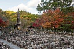 People at Adashino Nenbutsuji temple. Japanses people salute Buddha statue at Adashino Nenbutsuji temple with autumn foliage colors in Arashiyama, Kyoto, Japan Stock Images