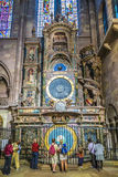 People admire the astronomical clock in the Cathedral of Strasbo Stock Photos
