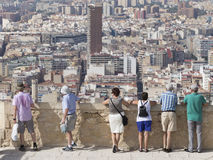 People admire the surroundings of Alicante Royalty Free Stock Image