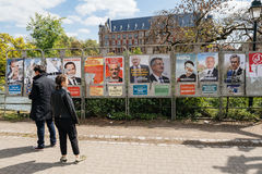 People admiring the elections posters on the voting day Royalty Free Stock Photography