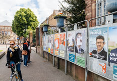 People admiring the elections posters on the voting day Royalty Free Stock Photo