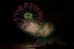 People admiring  fireworks from the beach  in Forte dei Marmi Royalty Free Stock Images