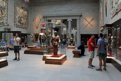People admiring the Knights,Castles and Kings collection,Cleveland Art Museum,Ohio,2016. Sightseers wandering around large room filled with art and artifacts in stock photos