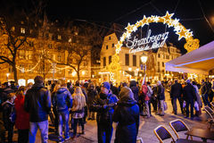People admiring neon sign Christmas Market, Captial de noel, Royalty Free Stock Photography