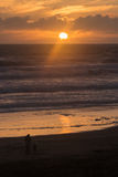 People admiring sunset at Muriwai Stock Photography