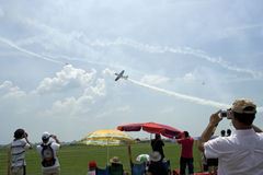 People on aerodrome at an aviation event, raw Royalty Free Stock Photos