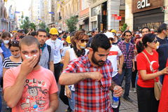 People affected by tear gas. ISTANBUL - JUN 1: Violence sparked by plans to build on the Gezi Park have broadened into nationwide anti government unrest on June Royalty Free Stock Image