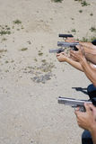 People Aiming Guns At Firing Range Royalty Free Stock Photo