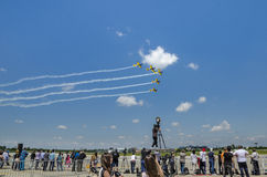 People at air show. Group of people with cameraman watching stunt planes fly at the Bucharest Air Show on June 22, 2014 in Bucharest, Romania Stock Photo