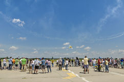 People at air show. People watching stunt plane flying at the Bucharest Air Show on June 22, 2014 in Bucharest, Romania Royalty Free Stock Photography