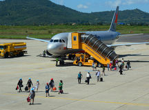 People and airplane on the runway at Lien Khang airport in Dalat, Vietnam Royalty Free Stock Photography