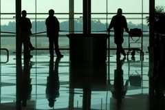 People in airport. People waiting at the international airport terminal stock photo