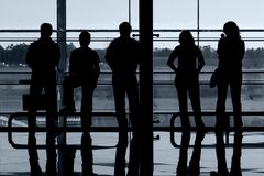 People at airport. People silhouettes at airport building Stock Photography