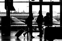People at the airport black and white. Some people at the airport black and white Stock Photography