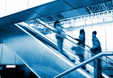 People at the airport escalator Stock Images